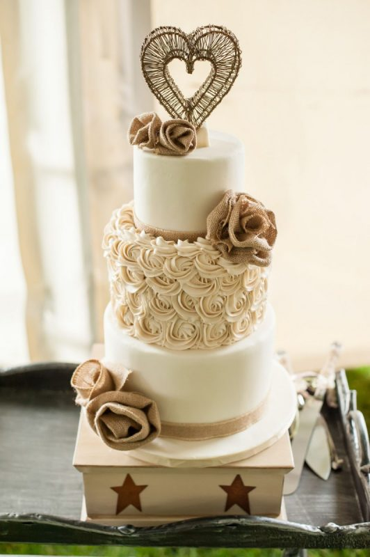 wedding cake with burlap flowers
